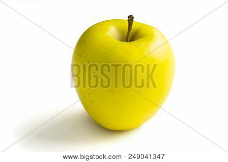 Close-up Of A Yellow Apple On A White Background.  View To A Apple On A Clean Background. Vegetarian