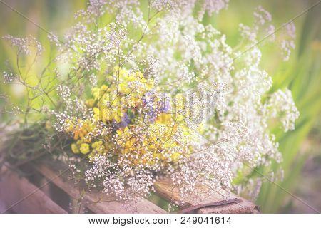 Bouquet Of Garden Flowers And Healing Herbs On Old Wooden Rustic Table. Close Up, Shallow Depth Of T