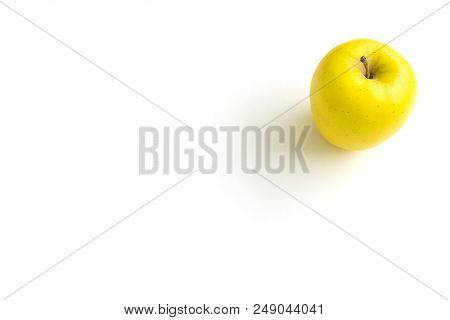 Close-up Of A Yellow Apple On A White Background.  View To A Fresh Yellow Apple On A Clean Backgroun