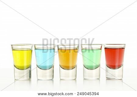 Close Up Of Five Colorful Shots On White