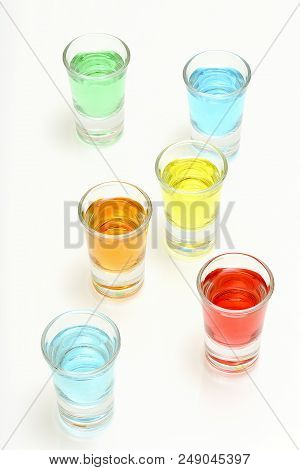 Six Colorful Cocktail Shots On White Background