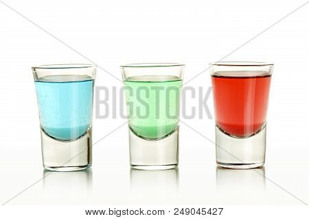 Close Up Of Three Colorful Shots On White