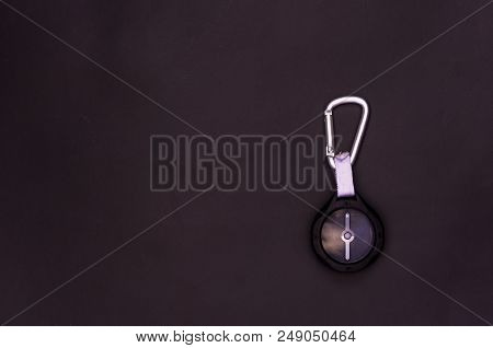 Black Compass With Carabiner. Compass On A Black Background. Tourist Compass.