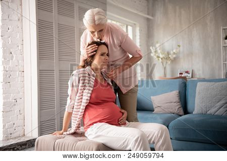 Feeling Dizzy. Caring Mother Feeling Extremely Worried While Pregnant Daughter Feeling Dizzy