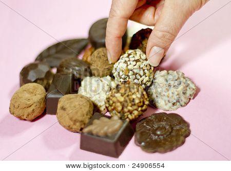 Grabbing A Truffle Chocolate