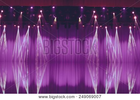 Blurred Lights On Stage With Purple Curtains Before The Show