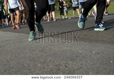 People Running In A Street Race On An Asphalt Surface
