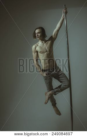 Man Dancing At Pole In A Fitness Studio - Ballet Dancer Working Out - Pole Dancer Stretching