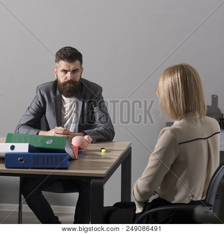 Bearded Man And Woman Have Business Meeting. Businessman And Businesswoman Sit At Office Desk. Conce