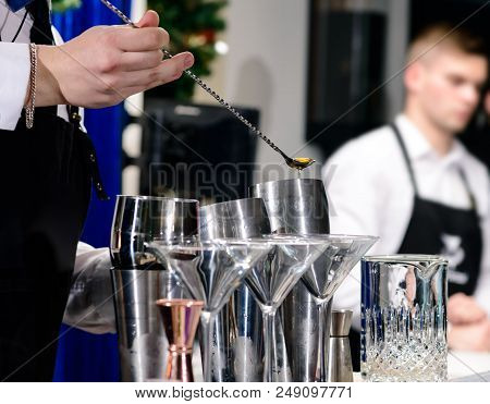 Unidentified Barman Preparing Cocktail At The Bar Counter