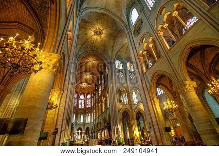 Paris, France - July 1, 2017: Interior Colonnade Panorama Of Notre Dame Gothic Cathedral Walking Of