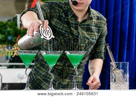 Unidentified Barman Adding Liquid In A Glass With Cocktail