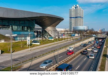 Munich, Germany - March 10, 2016: BMW four-cylinder tower Munich landmark which serves as world headquarters for Bavarian automaker. Stock photo with elements of designs Museum and Welt world