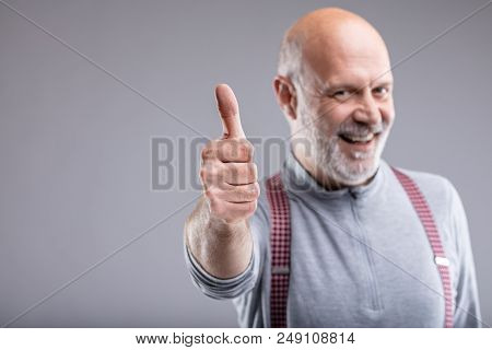 Smiling Mature Man With Thumb Up