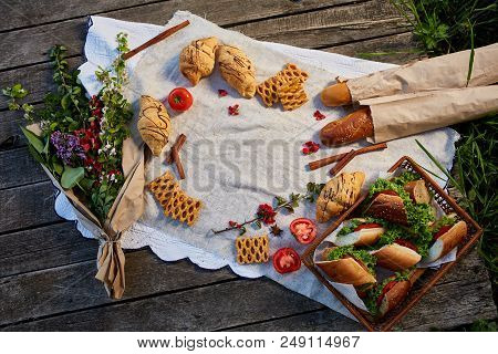 Picnic On A Green Lawn, Pastries And Vegetables On A Homespun Tablecloth, Summer Season, Flat Lay, S