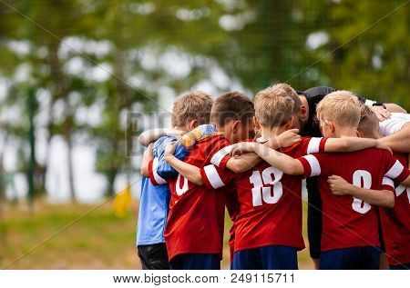 Boys Football Team With Coach. Youth Soccer Team Huddle With Coach. Motivation Talk, Pep Talk Before