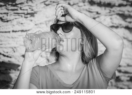 Thirsty Young And Attractive Caucasian Woman In Sunglasses Drinking Cold Water From A Plastic Bottle