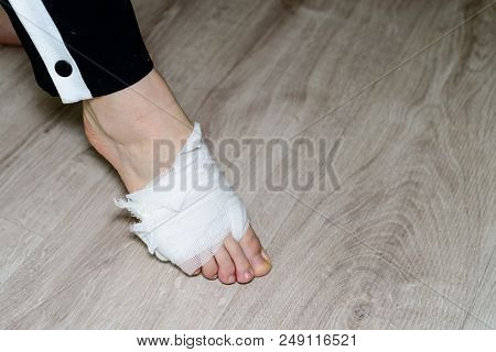 Injury Leg. Bandaged Leg Of Unidentified Person, Close-up
