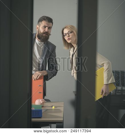 Troubled Colleagues Look Out Modern Office With Glass Walls. Business Couple At Meeting. Bearded Man