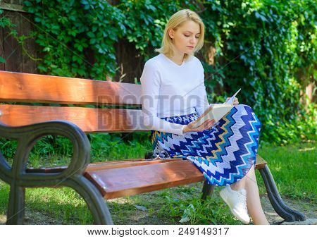 Ultimate Best Book List. Woman Blonde Take Break Relaxing In Park Reading Book. Girl Sit Bench Relax