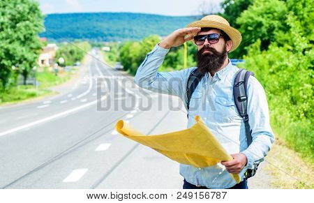 Man At Road Side With Map. Expeditor Backpacker Map Look Orienteering Direction. Orienteering Topogr