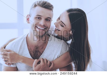 Portrait Of Beautiful Couple Hugging And Smiling. Handsome Man And Beautiful Pretty Woman Resting At