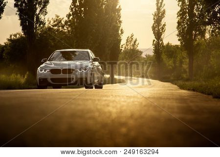 Engels, Russia - June 04, 2018: White Car Bmw 3 Series F30 Is Parked On Empty Countryside Asphalt Ro