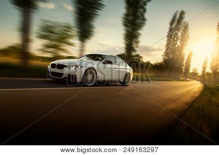 Engels, Russia - June 04, 2018: White Car Bmw 3 Series F30 Is Driving On Empty Countryside Asphalt R