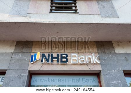 Szeged, Hungary, July 3, 2018: Nhb Bank Logo On Their Main Branch In The Center Of Szeged. Novekedes