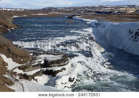 The Powerful Waters Of The Gullfoss Waterfall In Iceland
