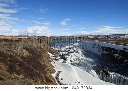 The Sweeping Landscape At The Gullfoss Waterfall In Iceland