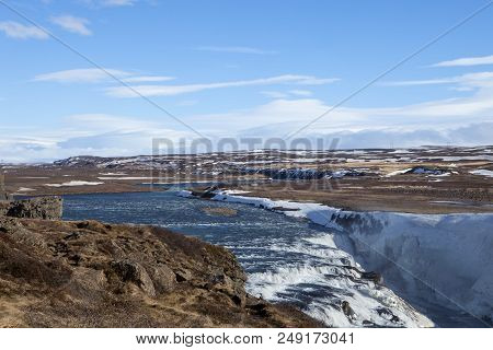 The Waters Of The Mighty Hvita River Feeds The Gullfoss Waterfall
