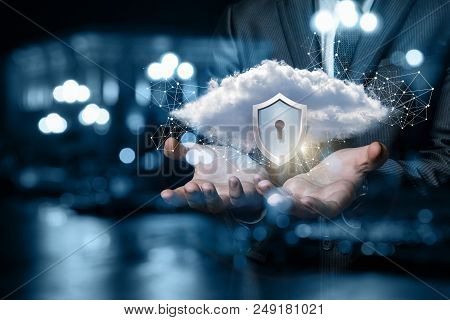 Data Protection Concept. Businessman Showing A Cloud With A Protective Shield.
