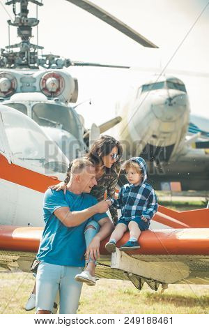 Vacation Concept. Happy Family Enjoy Summer Vacation At Military Air Show. Child With Mother And Fat