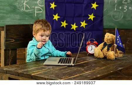 School Time. School Boy Use Laptop In Classroom With Eu Flag. Little Boy Study Computer In Elementar