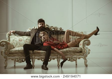 Couple In Love. Family Couple. Sexy Couple Of Bearded Man And Woman On Sofa. Couple Relax At Home. S