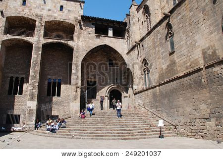 BARCELONA, SPAIN - APRIL 17, 2018: The medieval Placa del Rei (King's Square) in the Gothic Quarter of Barcelona. Its steps lead to the Royal Chapel of Saint Agatha.