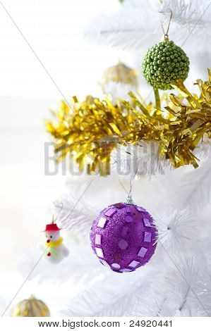 Baubles and little snowman on a Christmas Tree