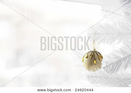 Golden bauble on Christmas Tree