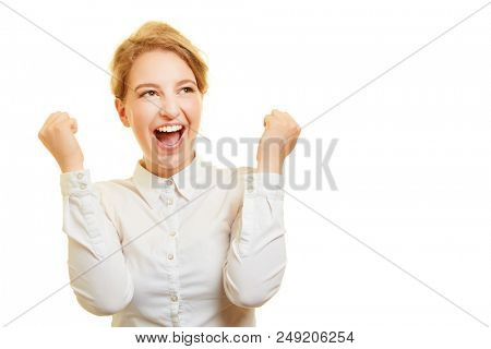 Young woman as winner and winner cheers and screams for joy