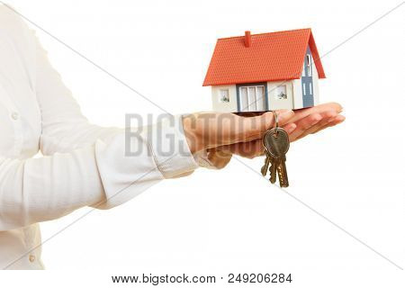 Small house with key on hand as house building or house purchase concept
