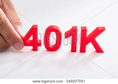 Businessperson holding red 401k pension plan on white background poster