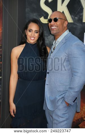 NEW YORK - JUN 10: Actor Dwayne Johnson (R) and  Simone Garcia Johnson attend the premiere of