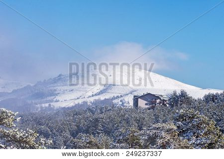 Winter Mountain Landscape. Mountain Snowy Hill With Conifers