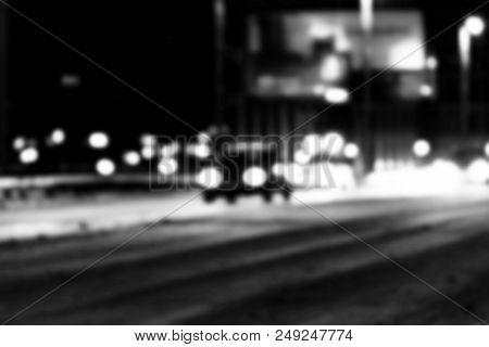 Night City View In Blur. City Speed Traffic Lights Blurry Photo. Street Life Bokeh Image. Street Wit