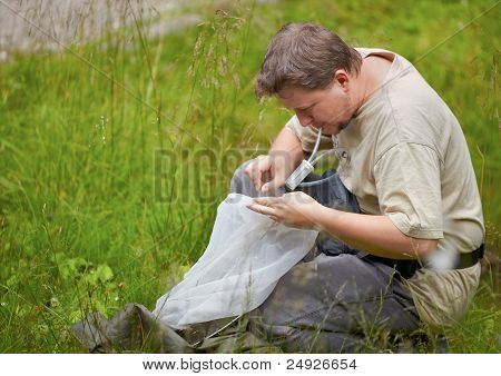 Entomologist In The Field