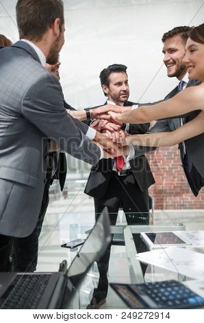 Business Team putting their hands together