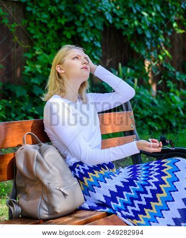 Girl Sit Bench Relaxing In Shadow, Green Nature Background. Woman Blonde Take Break Relaxing In Park