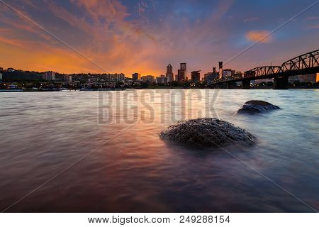 Portland Oregon Downtown City Skyline Along Willamette River At Sunset