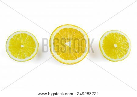 Sliced Orange And Lemons On A White Background. View From Above To Fresh Colorful Citrus Fruits On A